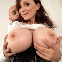 Brown-haired cougar Michaela O'Brilliant having gigantic boobs unsheathed before giving FELLATIO