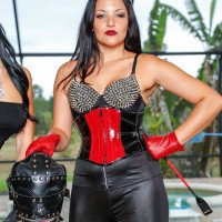 Dark haired Domina Kylie Rogue and wife abuse masked subby husband beside pool