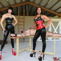 Brown-haired Dommes Jean Bardot and Michelle Lacy dominate dude on bondage table