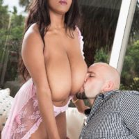 Brunette ebony MILF Rachel Raxxx whipping out gigantic saggy knockers from see-thru lingerie