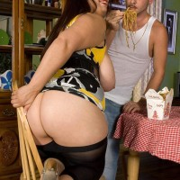 Black-haired feeder Rikki Waters baring monster-sized bum and juggs before licking wood in stilettos