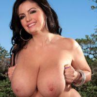 Brunette model Arianna Sinn showing off her large all natural titties outdoors
