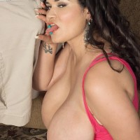 Dark haired Latina chunky Haydee Rodriguez uncovering humungous tits from dress