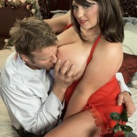Brunette MILF Angel Gee baring immense fun bags from see-through sundress for nipple sucking