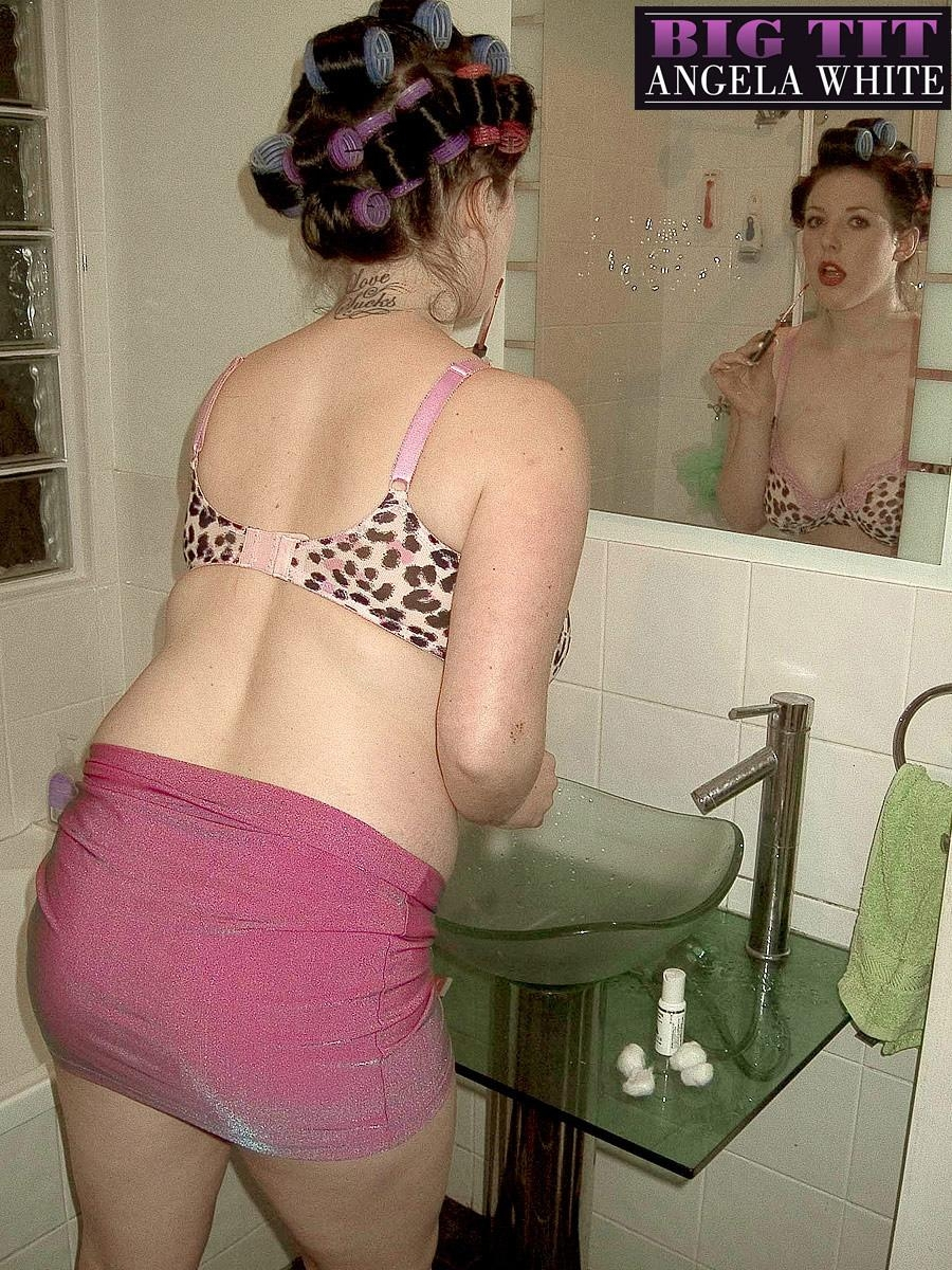 Brown-haired MILF Angela Milky modeling non nude in micro-skirt and in restroom and kitchen