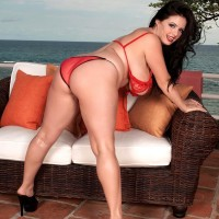 Black-haired MILF Arianna Sinn sets her massive melons loose of her unleashing brassiere