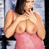 Brown-haired MILF Effie sets her large titties loose of wonderful lingerie in garters and hosiery