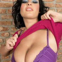 Dark-haired MILF Ivy Darmon sets her big all natural fun bags free in solo act