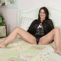 Brunette MILF Kaysy baring little tits and wide open fuckbox from sexy lingerie