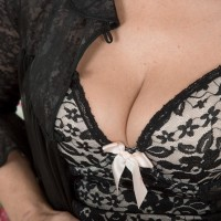 Black-haired MILF Kaysy baring petite breasts and wide open honeypot from enticing lingerie
