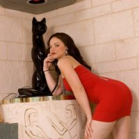 Dark haired MILF Leenuh Kai extracting flawless arse and muff underneath crimson dress