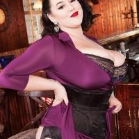 Dark haired MILF Lila Payne unleashing gigantic titties in black garters and nylons