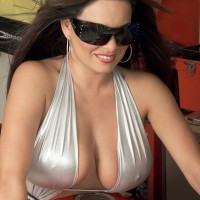 Brown-haired MILF Mia Starr letting out gigantic natural knockers on motorcycle in sunglasses