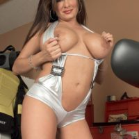 Black-haired MILF Mia Starr revealing massive all natural titties on motorcycle in sunglasses