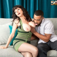 Brown-haired MILF over Fifty Karen Kougar seducing junior boy for sex on couch
