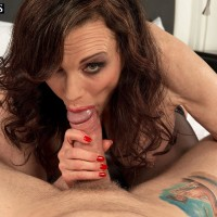 Black-haired MILF over 50 Michaela O'Brilliant flaunting monster-sized tits before providing blowjob