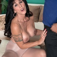 Brown-haired MILF over Fifty Moreen Helm unveiling big boobs for junior dude in hose