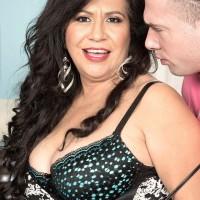 Dark haired MILF over 50 Victoria Versaci exposing humungous derriere while being disrobed