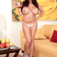 Black-haired MILF X-rated starlet Leanne Crow exposing immense tits in high-heeled shoes and mini-skirt