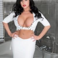Brunette MILF pornstar Sheridan Enjoy freeing flawless breasts and pierced nips in bathroom