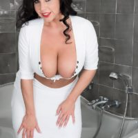 Brunette MILF pornstar Sheridan Enjoy freeing flawless breasts and pierced nips in bathroom