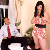 Brunette MILF XXX flick star Terry Nova providing hand job and oral job in fishnet body-stocking