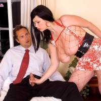 Brunette MILF XXX flick star Terry Nova providing hand job and oral job in fishnet body-stocking
