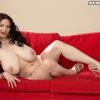 Dark haired MILF X-rated actress Vanessa Y letting large natural melons free in high heels