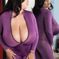 Dark-haired MILF Roxi Crimson letting humungous juggs free from plum jumper