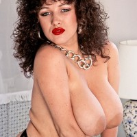 Dark-haired MILF Stacey Owen puts her gigantic knockers on demonstrate in garters and hose