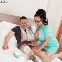 Dark haired MILF Tigerr Benson letting out immense titties before having sex on medical center bed