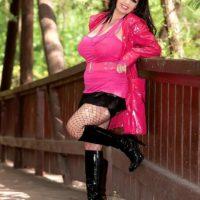 Brown-haired plumper Arianna Sinn demonstrates her gigantic knockers and upskirt bum outdoors