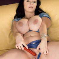 Dark-haired plumper Denisa unveiling adorable boobs and shaven slit in high heeled shoes