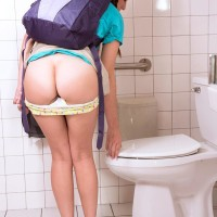 Brunette coed Kharlie Stone gliding panties over caboose before pissing