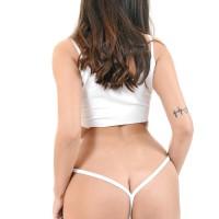 Brunette babe Alyssia Kent slurps a dildo after peeling off cut-offs and g-string