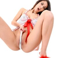 Brown-haired solo female Darcia Lee thumbs and dildos her trimmed cooter in red mules
