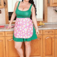 Brown-haired solo chick Juliana Simms letting huge knockers loose from sundress in kitchen