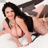 Dark haired solo chick Juliana Simms exposing giant all-natural juggs from lingerie
