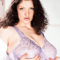 Dark-haired stunner Olga exposes her unshaven vagina after baring her gigantic funbags