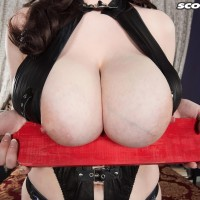 Dark-haired stunner Tiggle Bitties touches her enormous boobies garmented ebony lingerie