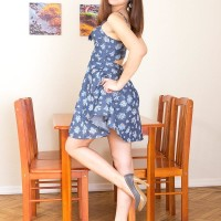 Brunette nubile Tara discarding dress to model bra-less in white cotton panties