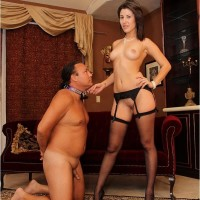 Brown-haired girlfriend Missy Daniels puts a collar on her masculine submissive and tramples him