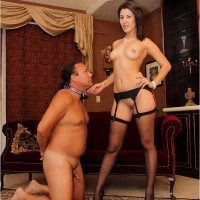 Dark haired girlfriend Missy Daniels puts a dog collar on her male submissive and stomps him