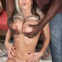Chesty 60 plus adult film star Sally D'Angelo gets ravaged by a younger black guy