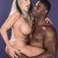 Big-chested Sixty plus XXX film starlet Sally D'Angelo gets ravaged by a younger ebony boy