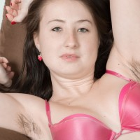 Buxom amateur Megan flashing hairy pits and furry cootchie underneath yoga pants