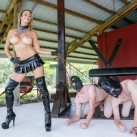 Bosomy sandy-haired Alexis Fawx keeps a duo of males submissives in bondage masks on leashes