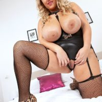 Chesty ash-blonde BIG BEAUTIFUL WOMAN Krystal Prompt munches a sex toy after showing her huge titties and smooth-shaven vagina