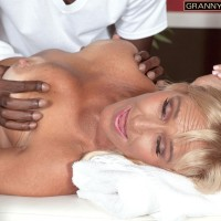 Chesty light-haired grannie Brittney Snow has her boobs played with by her black massagist