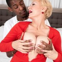 Big-titted platinum-blonde grandma Seka Black holds a Peeping Tom's hefty black cock in her hand